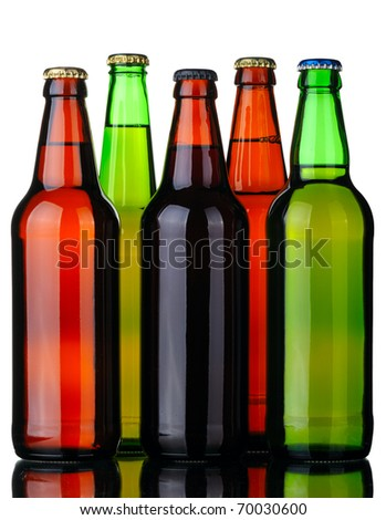 Bottles of lager and dark beer from brown and green glass, isolated on a white background. - stock photo