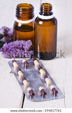 bottles of massage oil and aromatherapy spa - stock photo