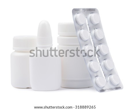 Bottles of medicines and pills in a blister pack. - stock photo