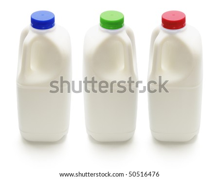 Bottles of Milk on Isolated White Background - stock photo