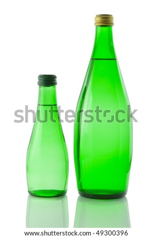 Bottles  of mineral water reflected on white background