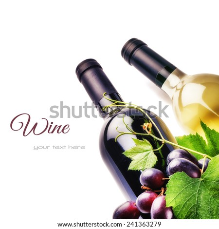Bottles of red and white wine with fresh grape isolated over white - stock photo