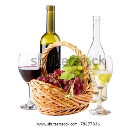Bottles of red and white wine with grapes, white background - stock photo