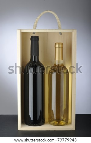 Bottles of  red wine and white wine  in a box - stock photo
