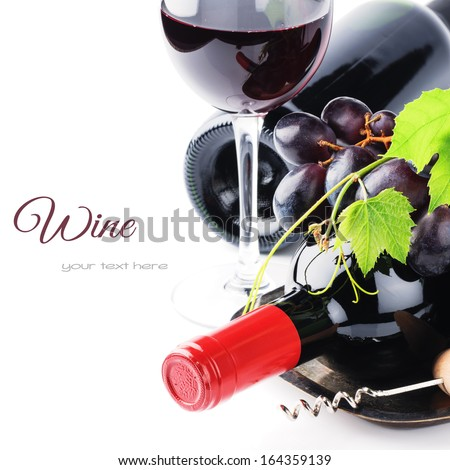 Bottles of red wine with fresh grape isolated over white - stock photo