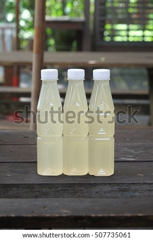 Bottles of sweet juice in the cafe, natural sweet, sugarcane , coconut juice , coconut sugar