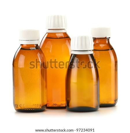 Bottles of syrup medication on white background - stock photo