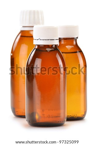 Bottles of syrup medication on white background - stock photo