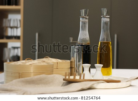 Bottles of the olive oil and balsamic vinegar, boxes, pepper and salt pot. - stock photo