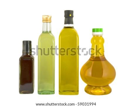 Bottles of vegetable oil isolated over white - stock photo