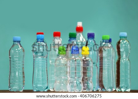 Bottles of water on the blue background. - stock photo