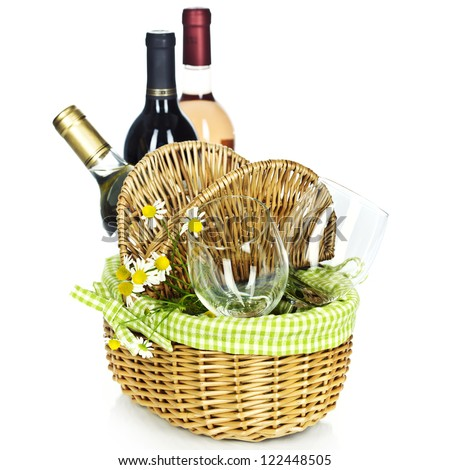 Bottles of wine and Picnic basket with glasses - stock photo