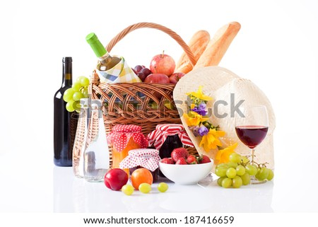 Bottles of wine, grape and Picnic basket with glasses - stock photo