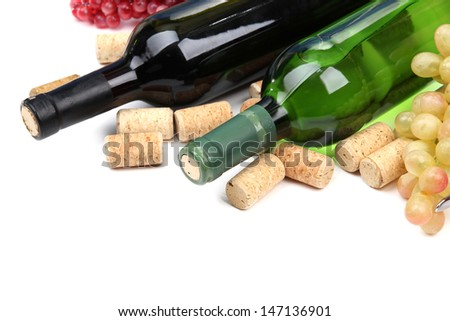 Bottles of wine, grapes and corks, isolated on white