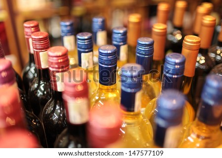 Bottles of wine in cellar  - stock photo