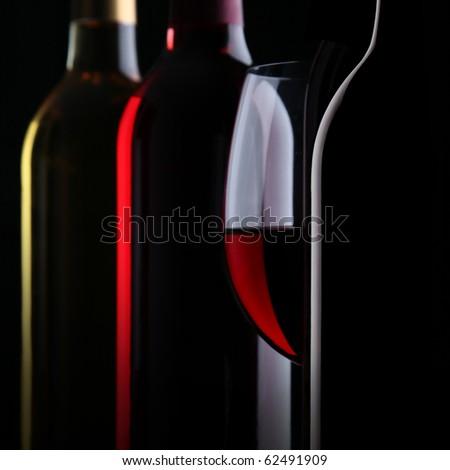 Bottles of wine on black background - stock photo