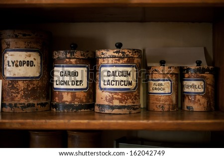 Bottles on the shelf in old pharmacy - stock photo