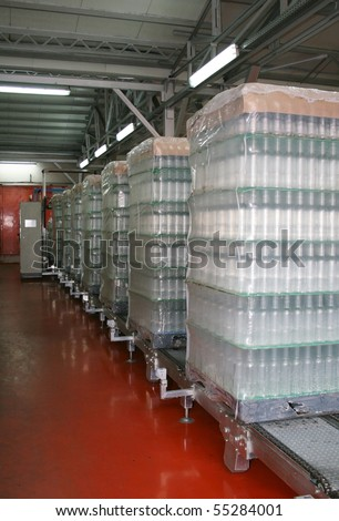 Bottles stored for delivery in depot - stock photo