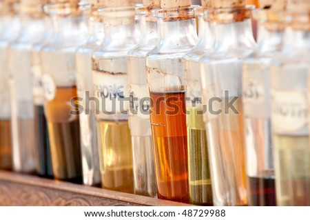 Bottles with basics oils, essentials and fragances aligned in a street market. - stock photo
