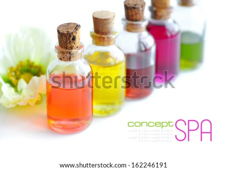 Bottles with basics oils isolated on white - stock photo