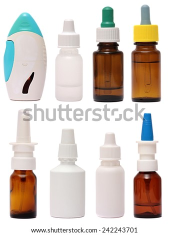 Bottles with drops and spray nasal drops isolated on white background . Medicine for a cold clipping path