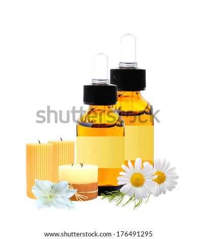 bottles with essence oil and chamomiles isolated on white - stock photo