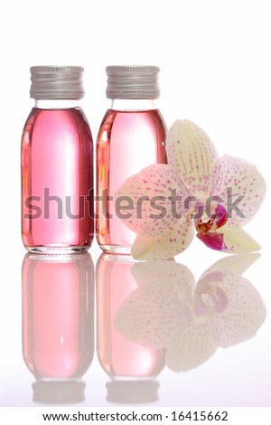bottles with essential oils and orchid isolated on white background - stock photo