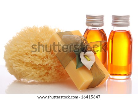 bottles with essential oils and sponge isolated on white background - stock photo