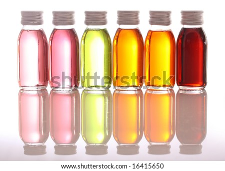 bottles with essential oils isolated on white background - stock photo