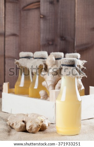 Bottles with homemade ginger syrup.  - stock photo