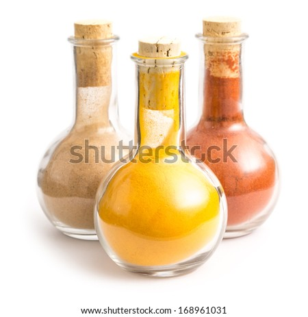 Bottles With Indian Spices Turmeric, Biryani And Kashmiri Isolated On White - stock photo