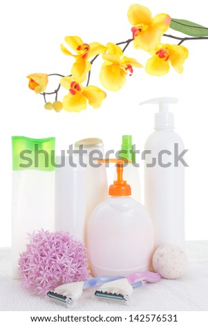 Bottles with liquid and hand-made soap, isolated on white