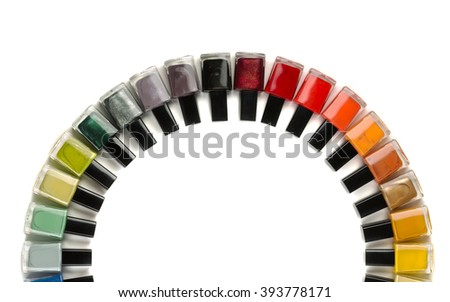 Bottles with nail polish arranged in a semicircle. Isolate on white. - stock photo
