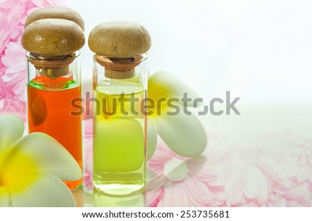 bottles with natural aroma oil on nature background - stock photo