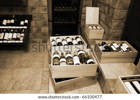 Bottles with old wine in liquor store - stock photo