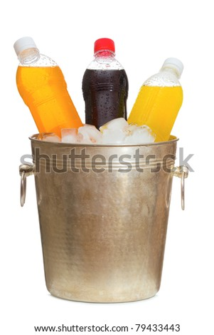 Bottles with soda in ice bucket on white background