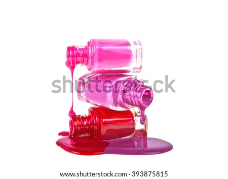 Bottles with spilled nail polish on a white background - stock photo