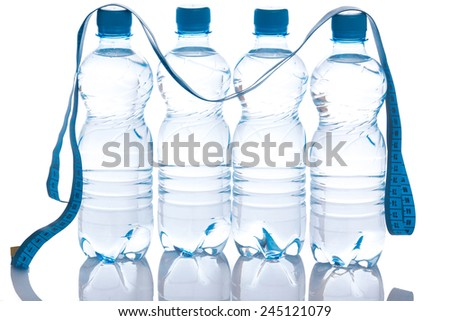 Bottles with water on white background - stock photo