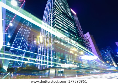 Bottom angle shooting highway car light trails of modern urban buildings in Hong Kong
