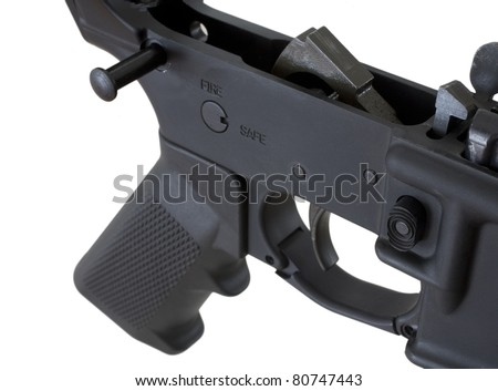 Bottom half of a modern assault rifle that is field stripped - stock photo