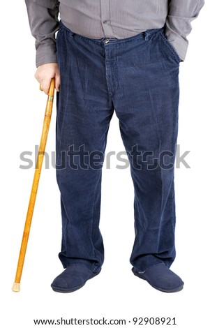 Bottom half of an old man or elderly person walking with a wood cane, wearing and blue corduroy and slippers, isolated on white.