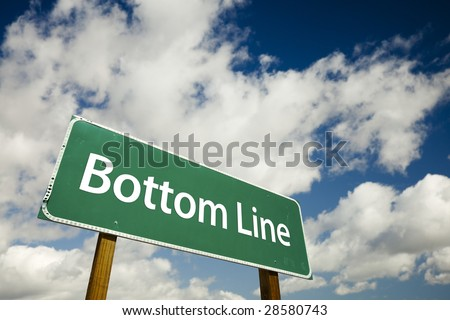 Bottom Line Road Sign with dramatic clouds and sky.