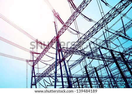 Bottom look up power transmission towers   - stock photo