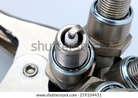 Bottom of the spark plug in close - stock photo