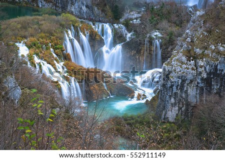 Bottom part of the Big waterfall of Plitvice national park, casting colour contrast with the trees in the autumn
