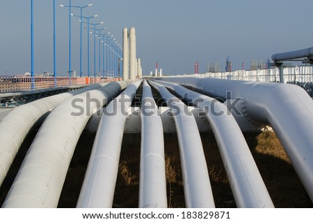 Bottom shot of a pipeline at sunset. Pipeline transportation is most common way of transporting goods such as Oil, natural gas or water on long distances  - stock photo