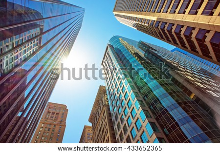 Bottom-up view of skyscrapers mirrored in glass in Philadelphia, Pennsylvania, USA. It is central business district in Philadelphia - stock photo