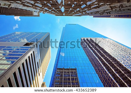 Bottom up view on skyscrapers mirrored in glass in Philadelphia, Pennsylvania, USA. It is central business district in Philadelphia - stock photo