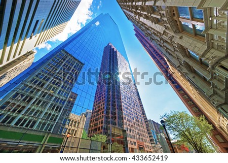 Bottom up view on skyscrapers reflected in glass in Philadelphia, Pennsylvania, USA. It is central business district in Philadelphia - stock photo