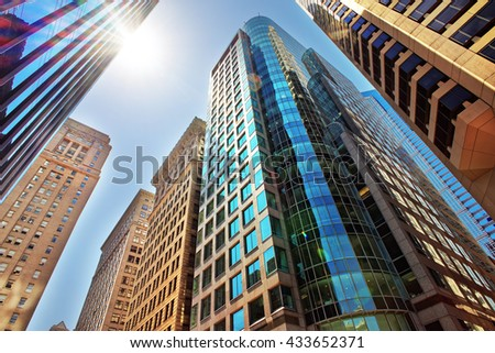 Bottom-up view to skyscrapers mirrored in glass in Philadelphia, Pennsylvania, USA. It is central business district in Philadelphia - stock photo